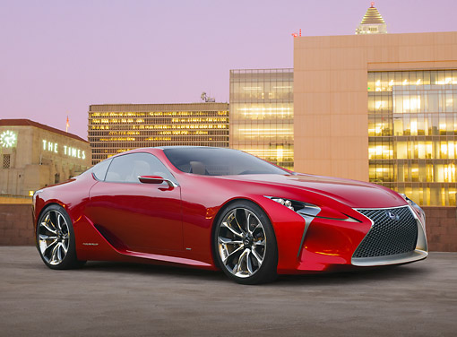 AUT 09 RK1283 01 © Kimball Stock Lexus LF-LC Concept Red 3/4 Front View On Parking Structure By Buildings At Dusk