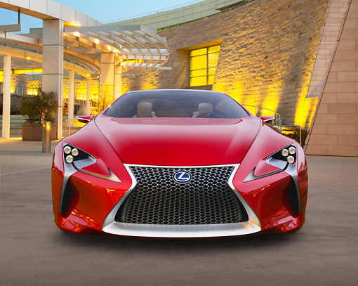 AUT 09 RK1285 01 © Kimball Stock Lexus LF-LC Concept Red Front View On Pavement By Building At Dusk