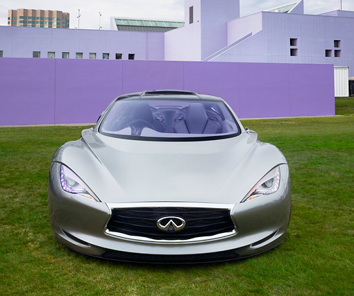 AUT 09 RK1287 01 © Kimball Stock Infiniti EMERG-E Concept Silver Front View On Grass By Purple Building