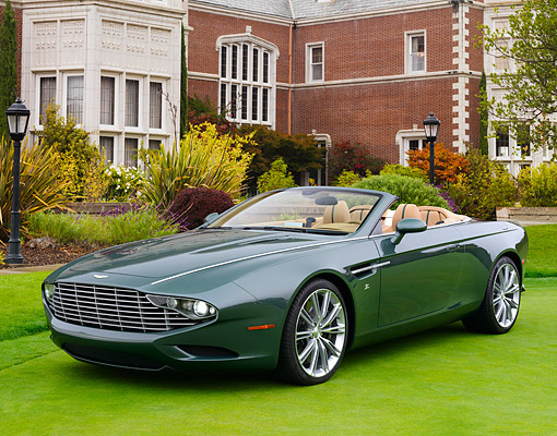 AUT 09 RK1298 01 © Kimball Stock Aston Martin Zagato Concept Green 3/4 Front View On Grass By Brick Building