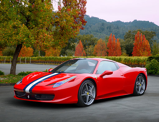 AUT 09 RK1299 01 © Kimball Stock 2013 Ferrari 458 Spyder Scuderia Red 3/4 Front View On Pavement By Autumn Foliage