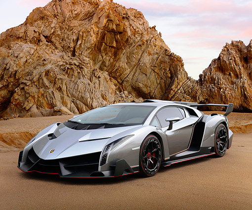 AUT 09 RK1310 01 © Kimball Stock Lamborghini Veneno Concept Silver 3/4 Front View On Sand By Rocky Cliffs