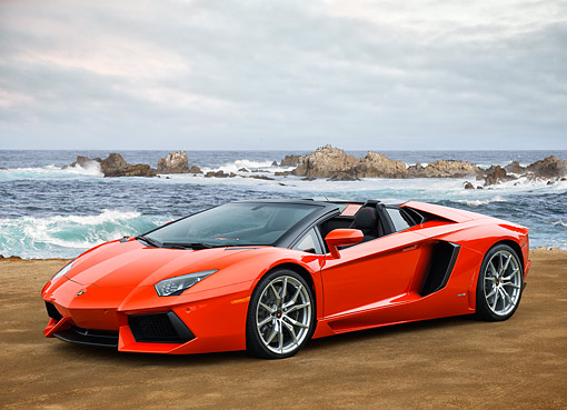 AUT 09 RK1325 01 © Kimball Stock 2014 Lamborghini Aventador LP 700-4 Roadster Red Side View On Rocky West Coast Beach