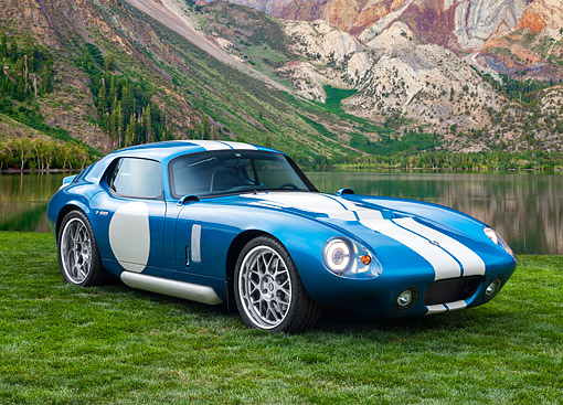 AUT 09 RK1336 01 © Kimball Stock Renovo Coupe Electric Supercar 3/4 Front View On Grass By Lake