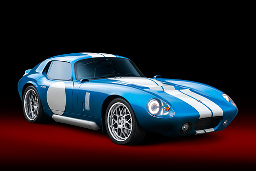 AUT 09 RK1345 01 © Kimball Stock Renovo Coupe 3/4 Front On Grass In Studio