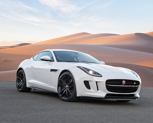AUT 09 RK1351 01 © Kimball Stock Jaguar C-X16 Concept White 3/4 Front View On Pavement By Desert Sands