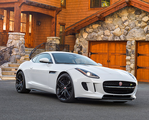 AUT 09 RK1356 01 © Kimball Stock Jaguar C-X16 Concept White 3/4 Front View On Pavement By House