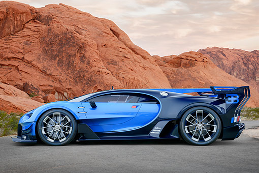 AUT 09 RK1376 01 © Kimball Stock Bugatti Vision Gran Turismo Concept Car Blue And Black Profile View On Road In Desert