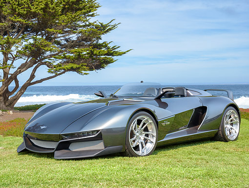 AUT 09 RK1379 01 © Kimball Stock Rezvani Beast Concept Car Silver 3/4 Front View On Grass By Ocean