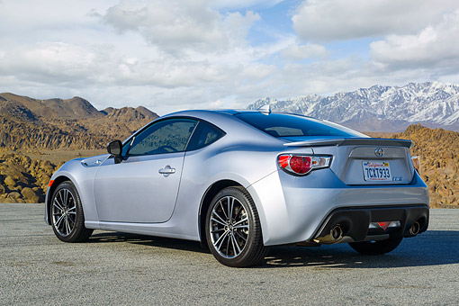 AUT 51 RK0075 01 © Kimball Stock 2015 Scion FR-S Silver 3/4 Rear View By Mountains