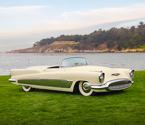 AUT 09 BK0005 01 © Kimball Stock 1951 Buick XP300 Concept Convertible White 3/4 Front View On Grass By Ocean