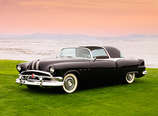 AUT 09 BK0008 01 © Kimball Stock 1953 Pontiac Parisienne Black Concept 3/4 Front View On Grass By Ocean
