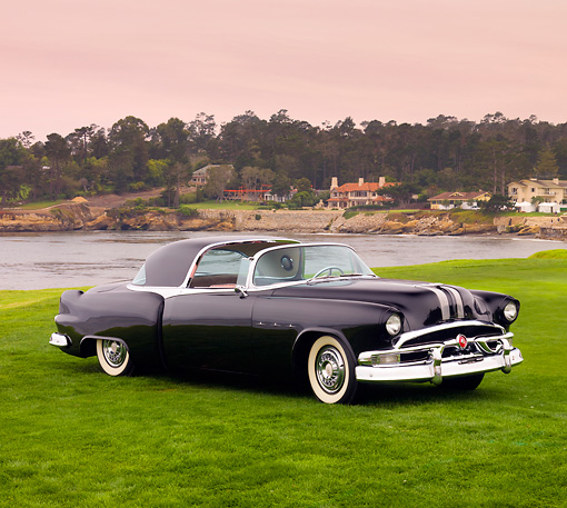 AUT 09 BK0009 01 © Kimball Stock 1953 Pontiac Parisienne Black Concept 3/4 Front View On Grass By Ocean