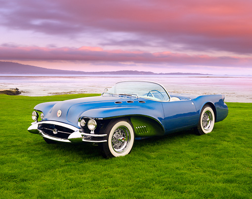 AUT 09 BK0011 01 © Kimball Stock 1954 Buick Wildcat II Convertible Blue Concept 3/4 Front View On Grass By Ocean
