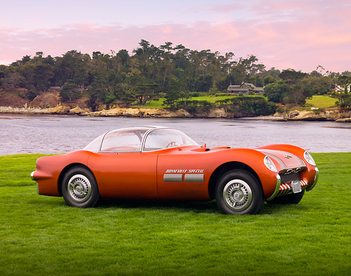 AUT 09 BK0012 01 © Kimball Stock 1954 Pontiac Bonneville Special Red Concept 3/4 Front View On Grass By Ocean