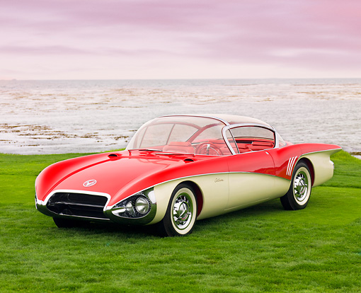 AUT 09 BK0015 01 © Kimball Stock 1956 XP-301 Buick Centurion Coupe Red And White Concept 3/4 Front View On Grass By Ocean
