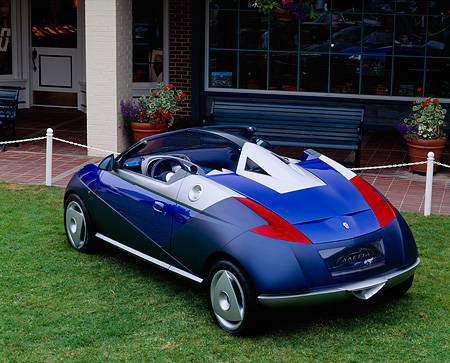 AUT 09 RK0043 05 © Kimball Stock Dark Blue Ford Saetta Ghia Concept Car Overhead 3/4 Rear View On Grass