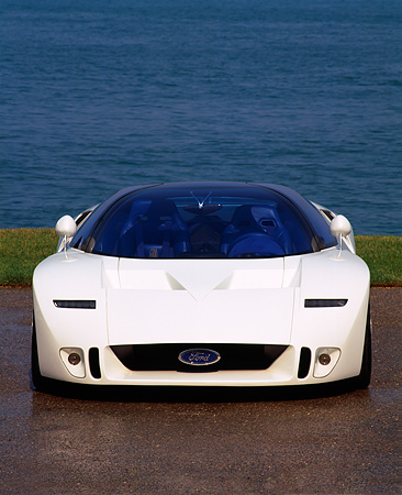 AUT 09 RK0073 03 © Kimball Stock Ford GT-90 Prototype White Head On View On Wet Pavement By Grass And Water