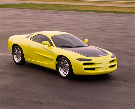 AUT 09 RK0114 02 © Kimball Stock 1994 Dodge Venom Concept Yellow 3/4 Front View On Pavement By Grass