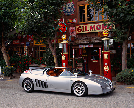 AUT 09 RK0144 04 © Kimball Stock Alfa Romeo Scighera Concept Silver 3/4 Side View In Front Of Antique Gas Station