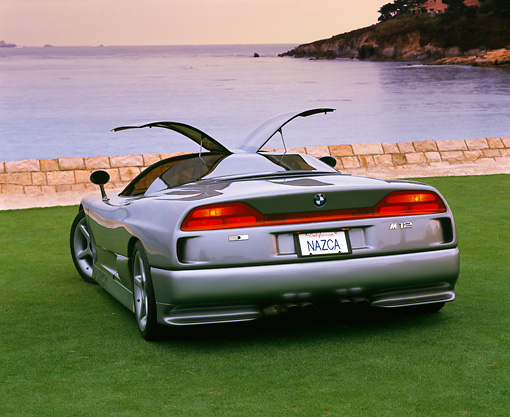AUT 09 RK0193 06 © Kimball Stock BMW Nazca Ital Design Silver Rear 3/4 View On Grass By Lake And Trees