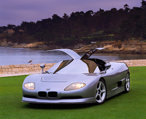 AUT 09 RK0194 02 © Kimball Stock BMW Nazca Ital Design Silver Front 3/4 View On Grass By Lake And Trees