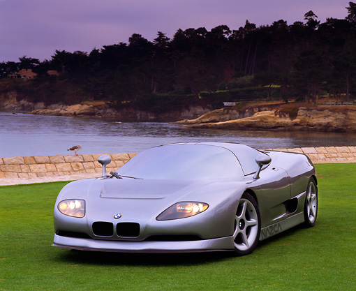 AUT 09 RK0195 01 © Kimball Stock BMW Nazca Italdesign Silver Front 3/4 View On Grass By Lake And Trees