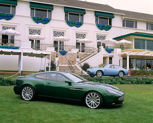 AUT 09 RK0206 04 © Kimball Stock 1998 Aston Martin Project Vantage Concept Car And 1962 Blue Aston Martin DB4 GT In Front Of The Lodge