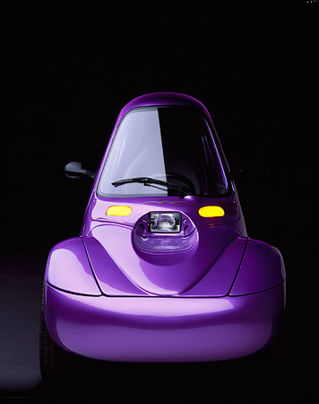 AUT 09 RK0213 02 © Kimball Stock 1998 Corbin Sparrow Electric Car Purple Head On View Parking Lights On Studio Background