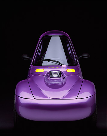 AUT 09 RK0213 06 © Kimball Stock 1998 Corbin Sparrow Electric Car Purple Head On View Parking Lights On Studio Background