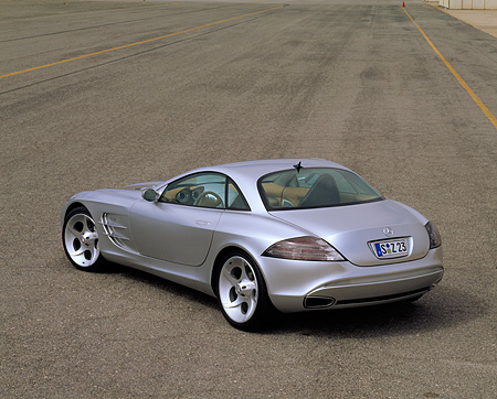 AUT 09 RK0265 01 © Kimball Stock Mercedes-Benz Vision SLR Silver Overhead 3/4 Rear View On Pavement