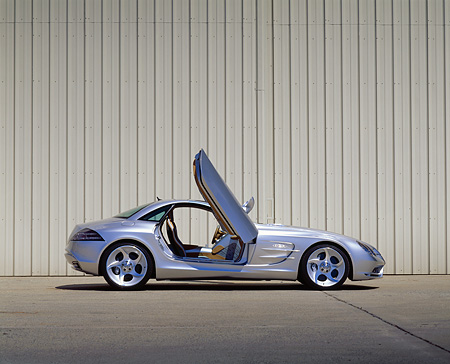AUT 09 RK0273 05 © Kimball Stock Mercedes-Benz Vision SLR Silver Profile Doors Open Against Wall On Pavement