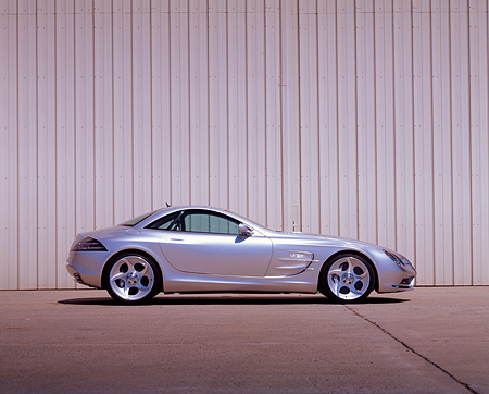 AUT 09 RK0274 02 © Kimball Stock Mercedes-Benz Vision SLR Silver Profile On Pavement Against Wall