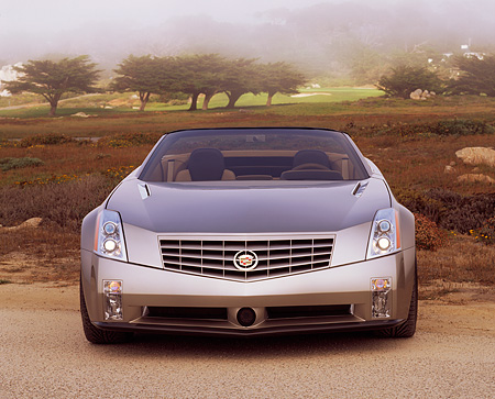 AUT 09 RK0307 03 © Kimball Stock Cadillac Evoq Convertible Silver Concept Car Head On Shot Trees Background Foggy