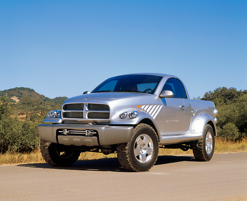 AUT 09 RK0313 05 © Kimball Stock Dodge Power Wagon Concept Truck Silver 3/4 Front View On Pavement Blue Sky
