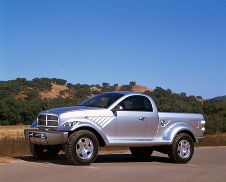 AUT 09 RK0316 01 © Kimball Stock Dodge Power Wagon Silver Concept Truck 3/4 Side View On Pavement By Hills Blue Sky