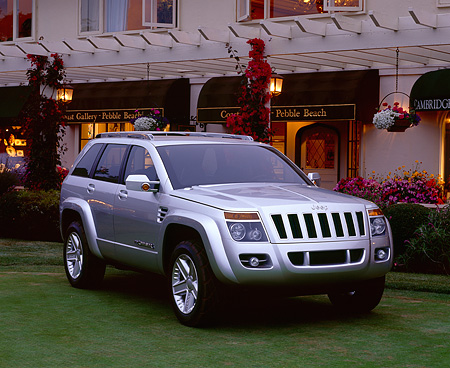 AUT 09 RK0339 03 © Kimball Stock Jeep Commander Silver Concept Car Front 3/4 View On Grass By Building At Dusk