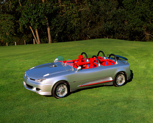 AUT 09 RK0345 08 © Kimball Stock Formula 4 Prototype Silver By Italdesign 3/4 Side View On Grass By Trees