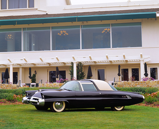 AUT 09 RK0355 01 © Kimball Stock 1953 Lincoln X-100 Black Concept Car 3/4 Side View On Grass