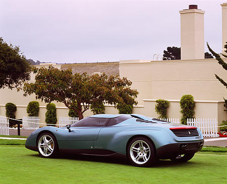 AUT 09 RK0368 03 © Kimball Stock Lamborghini Powered Raptor Concept Car 3/4 Rear View On Grass By Building