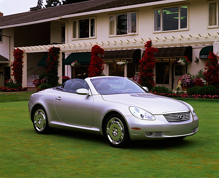 AUT 09 RK0389 06 © Kimball Stock Lexus SC430 Convertible Concept Silver 3/4 Side View On Grass By Building
