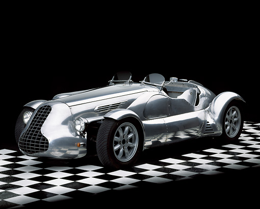 AUT 09 RK0429 06 © Kimball Stock Special Six Roadster Silver Front 3/4 View On Checkerboard Floor Studio