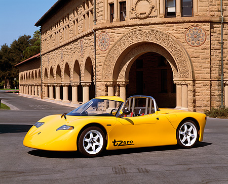 AUT 09 RK0449 06 © Kimball Stock AC Propulsion tZero Electric Sports Car Prototype Yellow Side 3/4 View On Pavement By Building