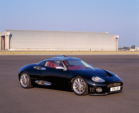 AUT 09 RK0455 01 © Kimball Stock Spyker C8 Laviolette Coupe Black 3/4 Front View On Pavement By Hangar