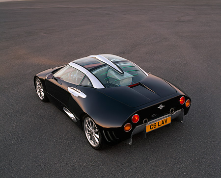 AUT 09 RK0464 04 © Kimball Stock Spyker C8 Laviolette Coupe Black Overhead 3/4 Rear View On Pavement