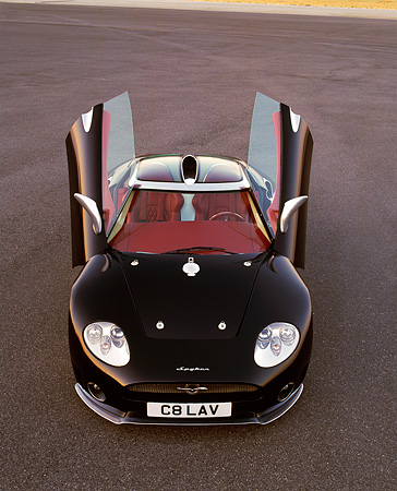 AUT 09 RK0466 02 © Kimball Stock Spyker C8 Laviolette Coupe Black Overhead Head On Shot Doors Up On Pavement
