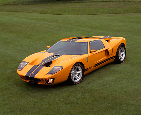 AUT 09 RK0490 03 © Kimball Stock Ford GT40 Prototype Orange With Black Stripes Overhead Front 3/4 View On Grass