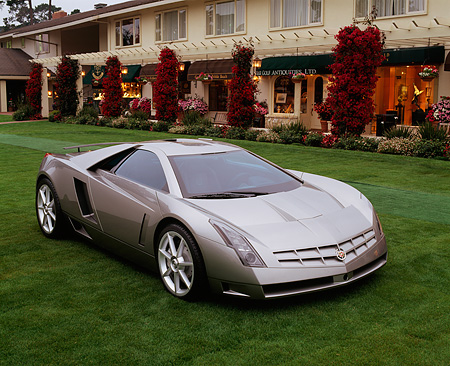AUT 09 RK0499 04 © Kimball Stock Cadillac Zien Silver 3/4 Front View On Grass By Building