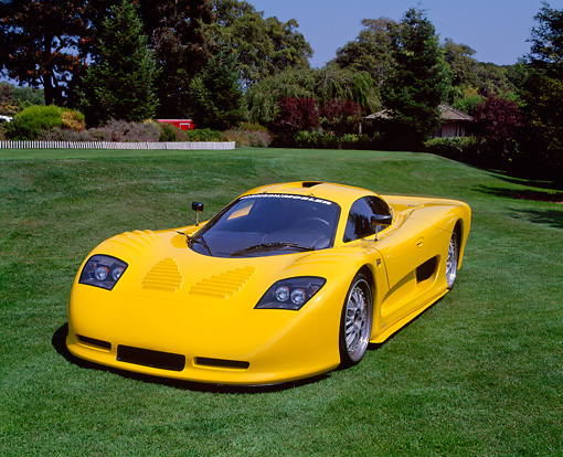 AUT 09 RK0510 02 © Kimball Stock 2002 Mosler MT900S Photon Yellow 3/4 Front View On Grass Trees Background