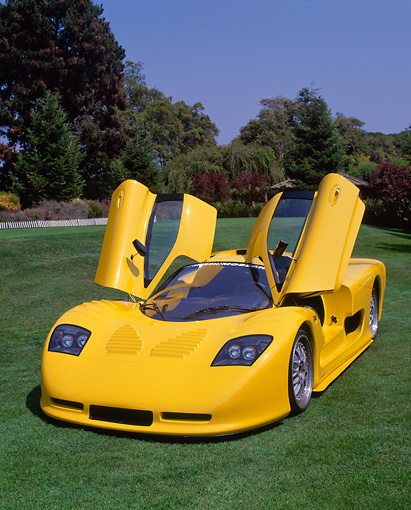 AUT 09 RK0511 03 © Kimball Stock 2002 Mosler MT900S Photon Yellow 3/4 Front View Doors Open On Grass Trees Background
